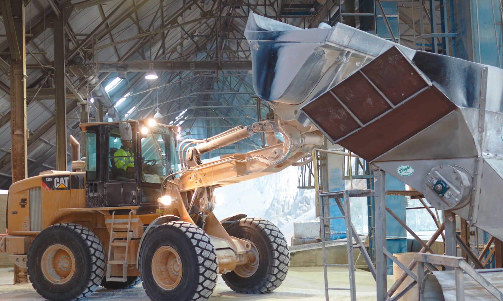 Photo of bulk product being loaded into a hopper for filtering