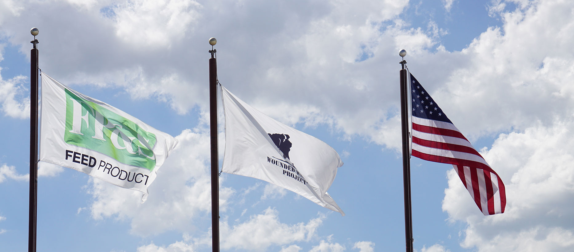 Three flags fly high at our Madison plant - the U.S. flag, Wounded Warrior Project and the Feed Products flag