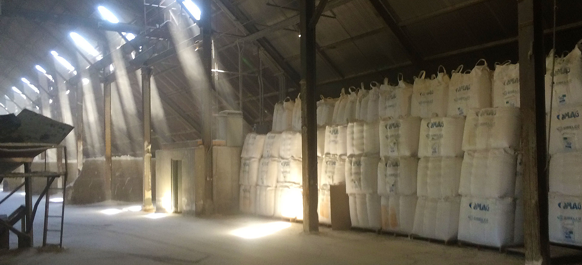 Photo of sunlight shining though to the inside of a warehouse at our Madison plant.